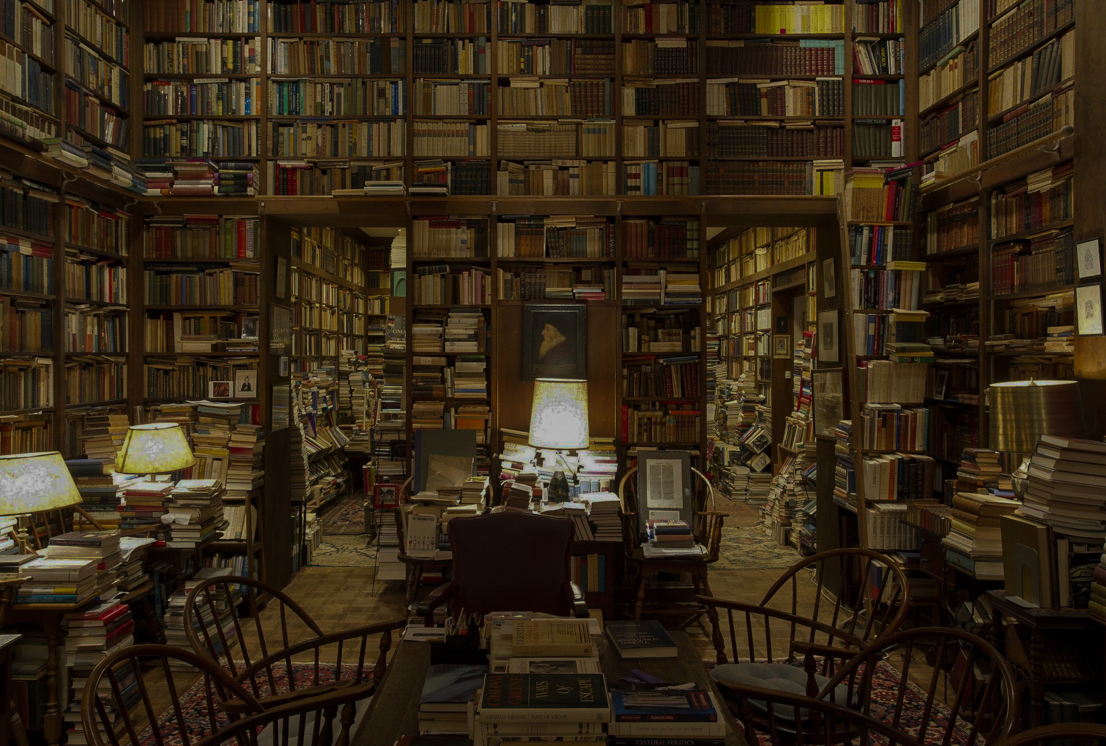 picture of an old library, with millions of books piled floor to ceiling